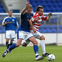 St Johnstone v Hamilton Accies..31.07.04  Bell's Cup<br />Ryan Stevenson battles with Mark Corcoran<br /><br />Picture by Graeme Hart.<br />Copyright Perthshire Picture Agency<br />Tel: 01738 623350  Mobile: 07990 594431