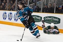 January 22, 2011; San Jose, CA, USA; San Jose Sharks defenseman Jason Demers (60) skates with the puck past Minnesota Wild right wing Brad Staubitz (16) during the first period at HP Pavilion. Mandatory Credit: Jason O. Watson / US PRESSWIRE