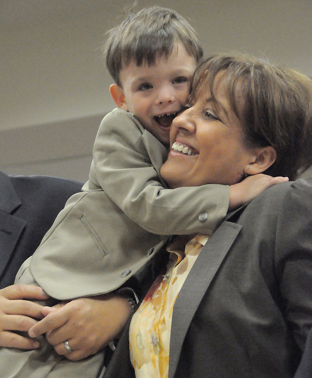 Nov. 22, 2011 -- Travis Moscoso, 4, hugs his new adoptive mother, Ligia Moscoso of Palm Bay, during an adoption ceremony Tuesday morning at the Moore Justice Center in Viera, where eight families adopted 13 children. ANDREW KNAPP, FLORIDA TODAY