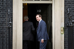 © Licensed to London News Pictures. 07/10/2013. London, UK. George Osborne, Chancellor of the Exchequer, is seen on Downing Street in London today (07/10/2013).. Photo credit: Matt Cetti-Roberts/LNP