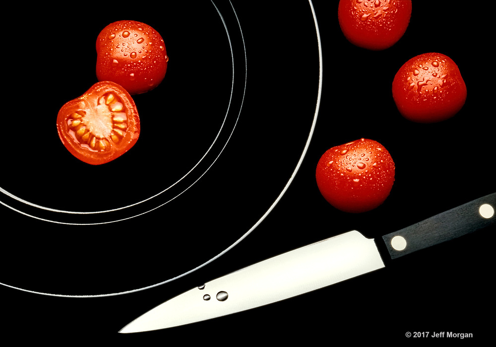 Still life of Tomatoes on a black plate