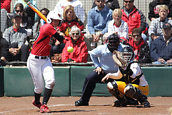 26 April 2015:   At bat for the Redbirds is Kara Repp (catching for the Ramblers is Annie Korth, home plate umpire is Steve McCrillis) during an NCAA Missouri Valley Conference (MVC) Championship series women's softball game between the Loyola Ramblers and the Illinois State Redbirds on Marian Kneer Field in Normal IL