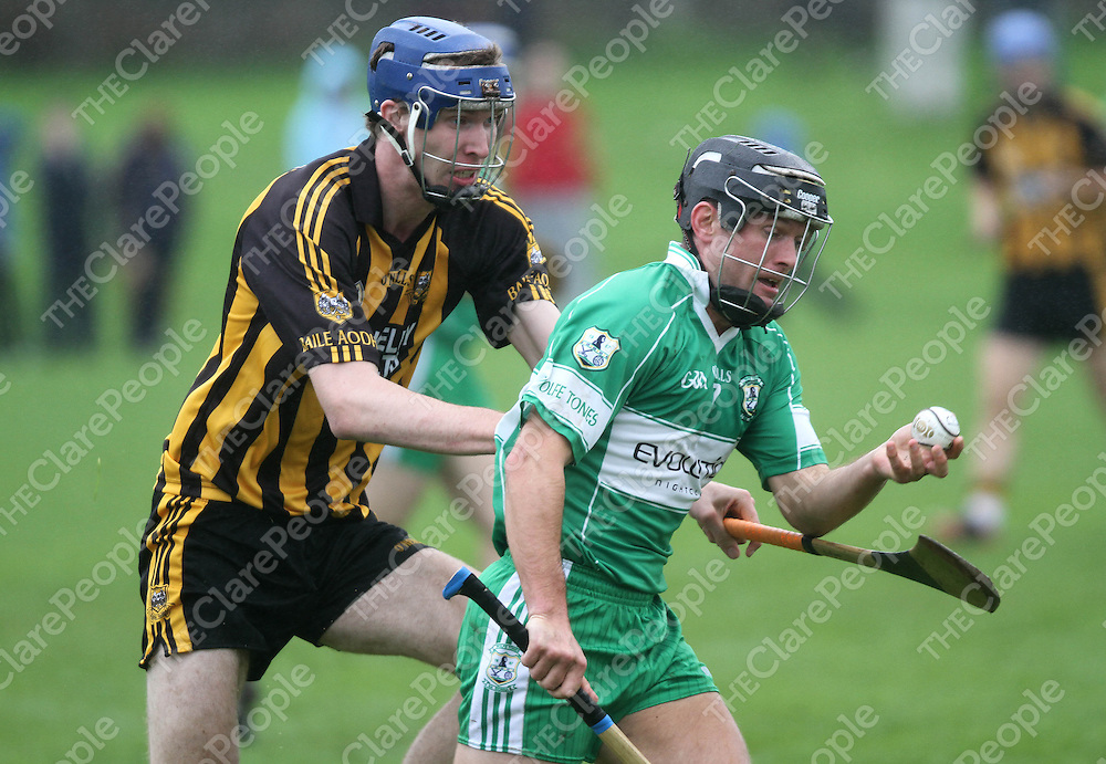 6/10/13 Wolf Tones Barry Loughanne shields the ball from Ballyeas Aonagh Keane during their clash in Newmarket.. Pic Tony Grehan / Press 22