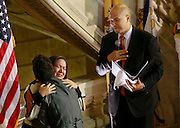 Newark Mayor and Senator-elect Cory Booker conducts a same-sex marriage ceremony for Gabriela Celeiro, center,  and Liz Salerno  in the rotunda of Newark City Hall  after 12:01 a.m. on Oct. 21, 2013, the first day gay marriages are legally allowed in New Jersey.