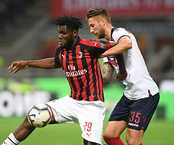 MILAN, May 7, 2019  AC Milan's Frank Kessie (L) vies with Bologna's Mitchell Dijks during a Serie A soccer match between AC Milan and Bologna in Milan, Italy, May 6, 2019. AC Milan won 2-1. (Credit Image: © Daniele Mascolo/Xinhua via ZUMA Wire)