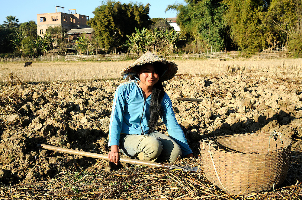 A young girl farming in Phonsavan, Laos.  Most of Laos consists of rural subsistance farmers.  Digging in soil heavily contaminated with bombs is a constant threat to life for farmers in the region.