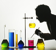 Graphic shot of  lab tech flasks,graduates & containers of brightly colored liquids.