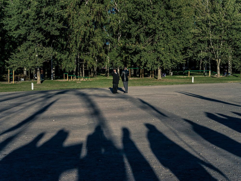 A pair of security service representatives observe a rally by independent union workers for better pay and jobs, held in a park on the north end of the city out of view of most people, ahead of presidential elections on Wednesday, October 7, 2015 in Minsk, Belarus. Nearly 80% of the Belarusian economy is state-run. President Alexander Lukashenko, a longtime iron-fisted ruler of Belarus, was elected to a fifth term with a reported 83.5% of the vote, which international monitors said did not meet democratic standards.