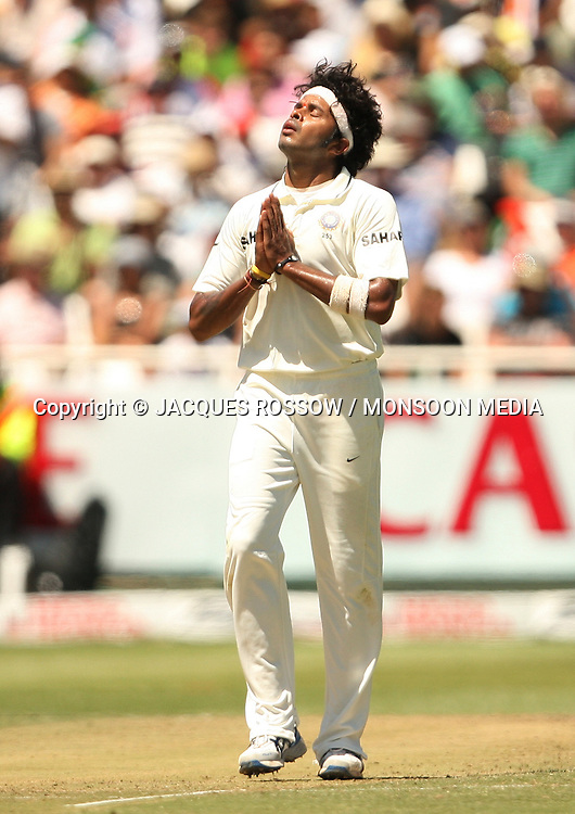Sree Sreesanth says a quick prayer after dismissing Morne Morkel during Day 2 of the third and final Test between South Africa and India played at Sahara Park Newlands in Cape Town, South Africa, on 2 January 2011. Photo by Jacques Rossouw / MONSOON MEDIA