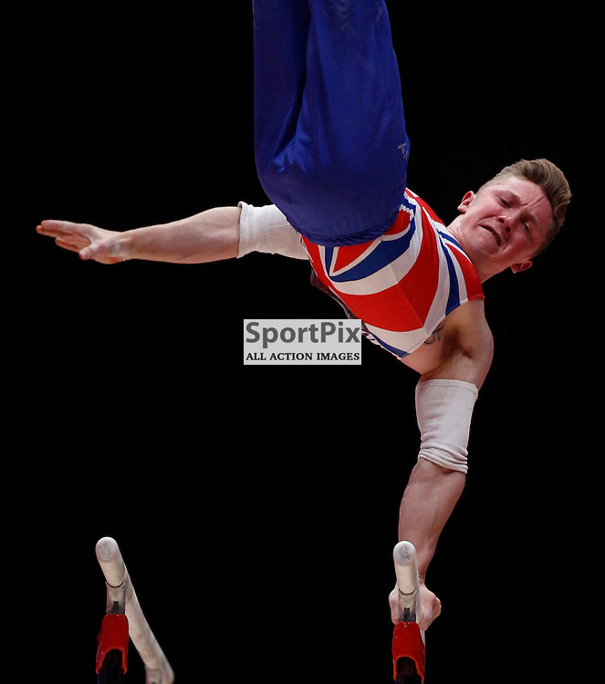 2015 Artistic Gymnastics World Championships being held in Glasgow from 23rd October to 1st November 2015.....Great Britain's Nile Wilson performs on the Parallel Bars on Day 2 of the Women's & Men's Apparatus Final...(c) STEPHEN LAWSON | SportPix.org.uk