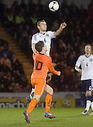 Scotland's Liam Kelly rises above Holland's Marco Vanginkel - Scotland v Holland - UEFA U21 European Championship qualifier at St Mirren Park..© David Young - .5 Foundry Place - .Monifieth - .Angus - .DD5 4BB - .Tel: 07765 252616 - .email: davidyoungphoto@gmail.com.web: www.davidyoungphoto.co.uk
