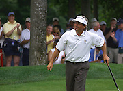 Jun 26, 2006; Gaylord MI; USA;  Fred Couples smiles after picking up his birdie put ther final skin and the win at the 2006 ING Par-3 Shootout at Treetops Resort in Gaylord Michigan.
