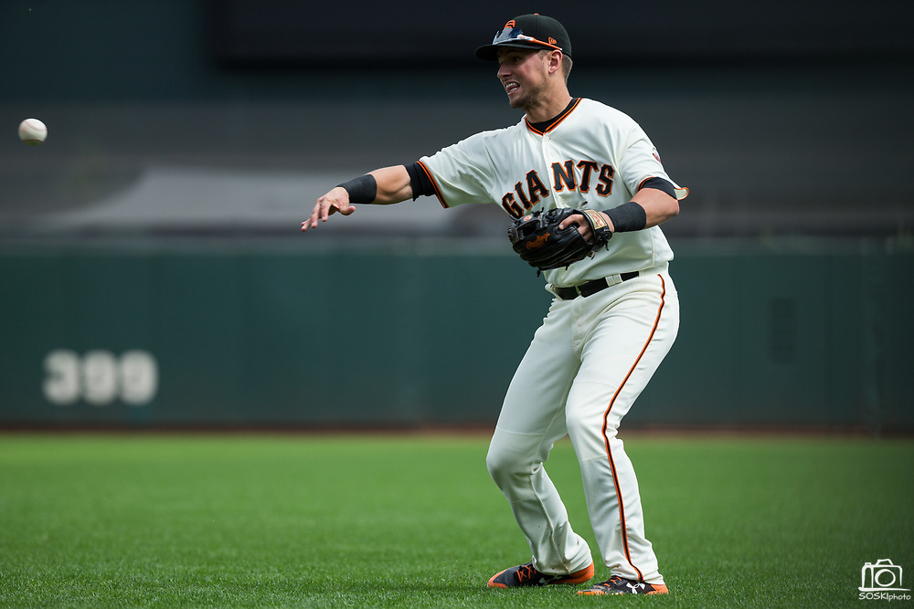 San Francisco Giants second baseman Joe Panik (12) fields a Colorado Rockies ground ball at AT&T Park in San Francisco, California, on September 20, 2017. (Stan Olszewski/Special to S.F. Examiner)