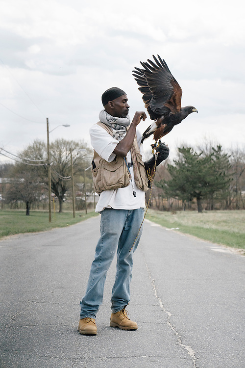 Rodney Stotts sits with his Harris Hawk, Agnes, at the Wings Over America raptor sanctuary in Maryland on March 17, 2016. Stotts takes the birds out for hunts around the property, with the raptor following closely behind their owner waiting for prey.