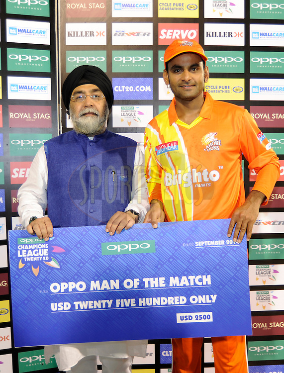 Mohammad Hafeez Captain of Lahore Lions receives the man of the match award during the presentation after the qualifier 5 match of the Oppo Champions League Twenty20 between the Southern Express and the Lahore Lions held at the Chhattisgarh International Cricket Stadium, Raipur, India on the 16th September 2014<br /> <br /> Photo by:  Pal Pillai / Sportzpics/ CLT20<br /> <br /> <br /> Image use is subject to the terms and conditions as laid out by the BCCI/ CLT20.  The terms and conditions can be downloaded here:<br /> <br /> http://sportzpics.photoshelter.com/gallery/CLT20-Image-Terms-and-Conditions-2014/G0000IfNJn535VPU/C0000QhhKadWcjYs