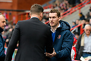 Exeter City manager Matt Taylor shakes hands with Grimsby Town manager Michael Jolley before the EFL Sky Bet League 2 match between Exeter City and Grimsby Town FC at St James' Park, Exeter, England on 29 December 2018.