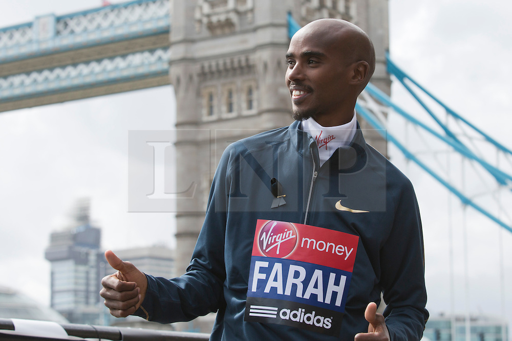© Licensed to London News Pictures. 18/04/2013. London, England. Picture: Mo Farah, British Runner, double Olympic gold medallist, who will attempt a half marathon on 21 April. Virgin London Marathon - Photocall with British Marathon Runners Athletes Scott Overall, Amy Whitehead and Mo Farah at Tower Bridge, London, ahead of Sunday's race. Photo credit: Bettina Strenske/LNP
