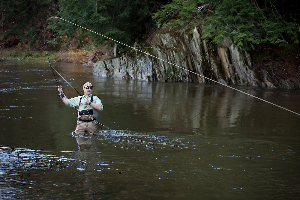 Angler and guide, Drew Price tight to a fish on the Dog River in central Vermont