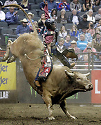 Danilo Carlos Sobrinho of Brazil rides Hedoo during a Professional Bull Riders competition at the Sprint Center, in Kansas City, Mo., Sunday, March 24, 2019. (AP Photo/Colin E. Braley)