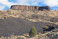 Rocky hillside cliffs made of basalt columns and Trout Creek climbing area in central Oregon USA.