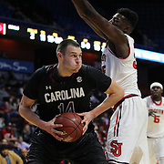 Laimonas Chatkevicius, South Carolina, drives to the basket defended by Yankuba Sima, St. John's, during the St. John's vs South Carolina Men's College Basketball game in the Hall of Fame Shootout Tournament at Mohegan Sun Arena, Uncasville, Connecticut, USA. 22nd December 2015. Photo Tim Clayton