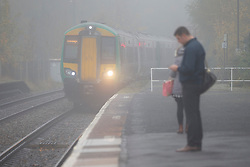 © Licensed to London News Pictures. 02/11/2015. Stourbridge, UK. A train approaches Stourbridge train station in heavy fog in West Midlands on Monday, 2 November 2015. Photo credit: Tolga Akmen/LNP