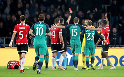Tottenham Hotspur goalkeeper Hugo Lloris (third right) is sent-off by match referee Slavko Vincic (centre)