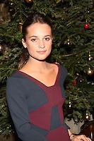 LONDON - December 17:<br /> Alicia Vikander<br /> Nordoff Robbins Christmas Carol Concert.<br /> 17, 12, 2013.<br /> St Luke's, London, United Kingdom<br /> (Photo  John Marshall/JM Enternational)
