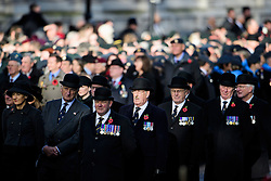 © Licensed to London News Pictures. 13/11/2016. London, UK.  Former servicemen watch as members of the Royal family and politicians attend a Remembrance Day Ceremony at the Cenotaph war memorial in London, United Kingdom, on November 13, 2016 . Thousands of people honour the war dead by gathering at the iconic memorial to lay wreaths and observe two minutes silence. Photo credit: Ben Cawthra/LNP