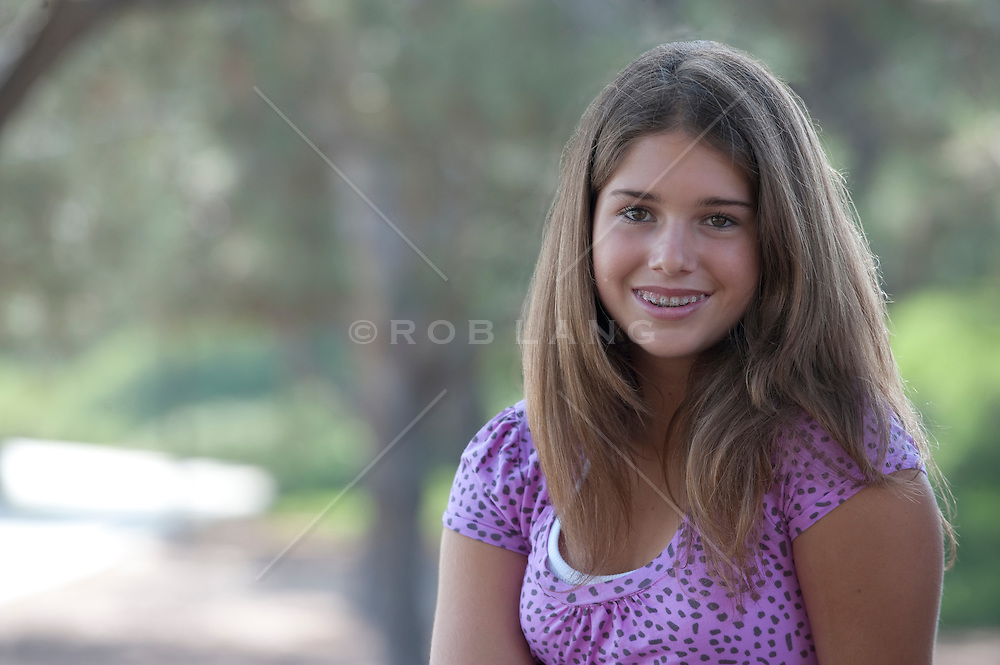 girl with braces outdoors