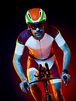 one caucasian man cyclist cycling bicycle triathlon isolated on black background