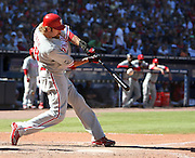 ATLANTA - OCTOBER 3:  Outfielder Jason Werth #28 of the Philadelphia Phillies connects for a two run home run during the game against the Atlanta Braves at Turner Field on October 3, 2010 in Atlanta, Georgia.  The Braves beat the Phillies 8-7.  (Photo by Mike Zarrilli/Getty Images)