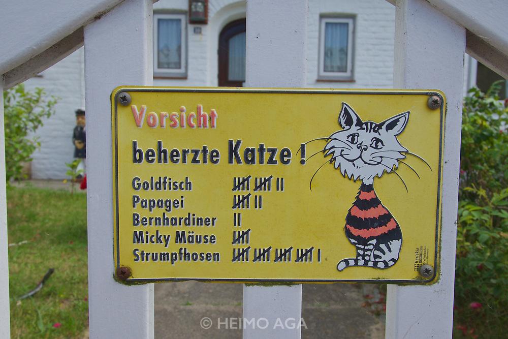 Sylt, Germany. Hörnum. Danger - mean cat!
