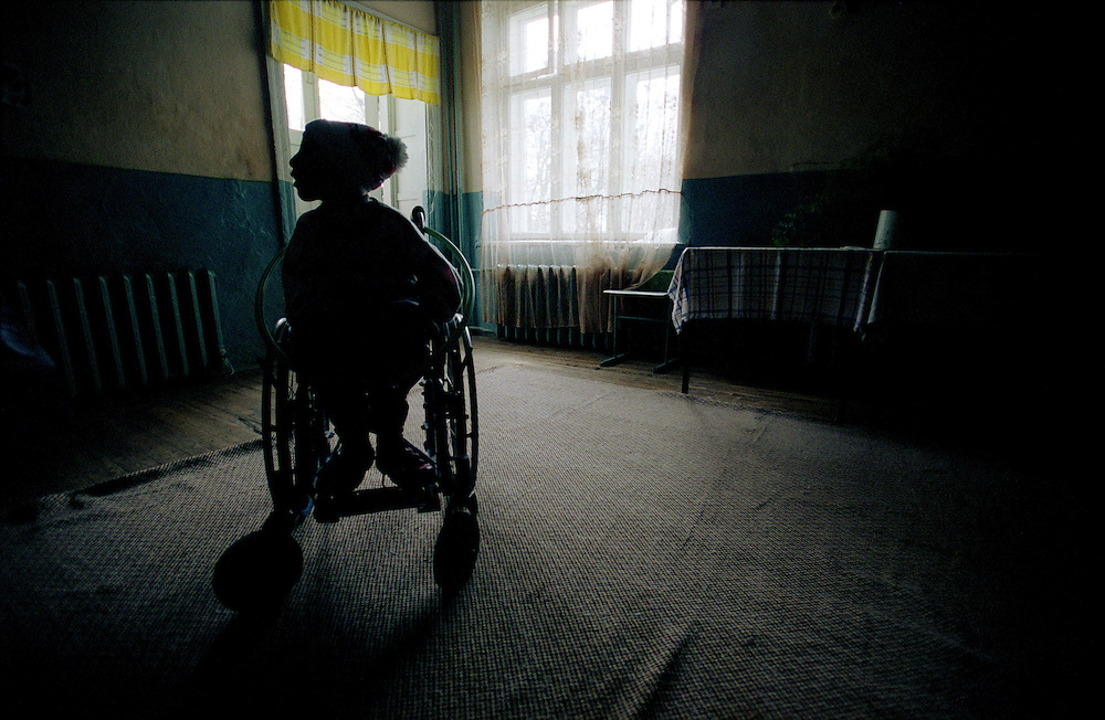 Chernobyl Legacy. ..Ukraine 2001...Children that no one wants live in an orphanage in Zaluzhya. Many of the children here who were born shortly after the Chernobyl accident are sick and show sympthoms that could be related to radiation, but most of them have never met a doctor. The orphange have very small fundings and is constantly understaffed...Photo: Markus Marcetic/MOMENT..