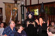 "Tamra Francis (left, standing) and Elena Monigold during Mayhem & Mystery's production of ""Costume Carousing"" at the Spaghetti Warehouse in downtown Dayton, Monday, September 12, 2011."