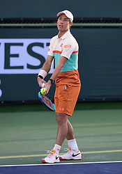 March 8, 2019 - Indian Wells, CA, U.S. - INDIAN WELLS, CA - MARCH 08: Kei Nishikori (JPN) serving in the first set of a doubles match during the BNP Paribas Open played at the Indian Wells Tennis Garden in Indian Wells, CA. (Photo by John Cordes/Icon Sportswire) (Credit Image: © John Cordes/Icon SMI via ZUMA Press)