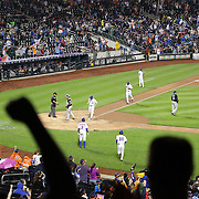 New York Mets fans delight as Wilmer Flores, New York Mets, hits a grand slam home run during the Mets ten run fourth inning during the New York Mets Vs Milwaukee Brewers.  MLB regular season baseball game at Citi Field, Queens, New York. USA. 16th May 2015. Photo Tim Clayton