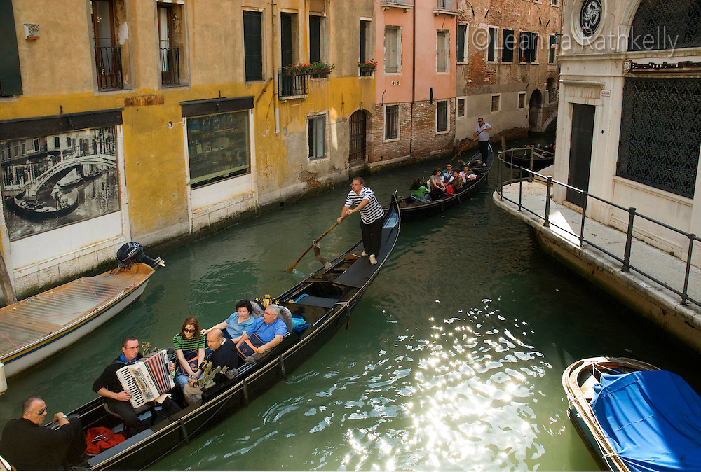 Gondola boats ply the narrow canals of Venice, Italy.