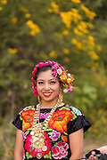 A traditional costumed young woman folk dancer wearing a Zapotec embroidered dress poses during the Day of the Dead Festival known in spanish as Día de Muertos on October 29, 2014 in Oaxaca, Mexico.