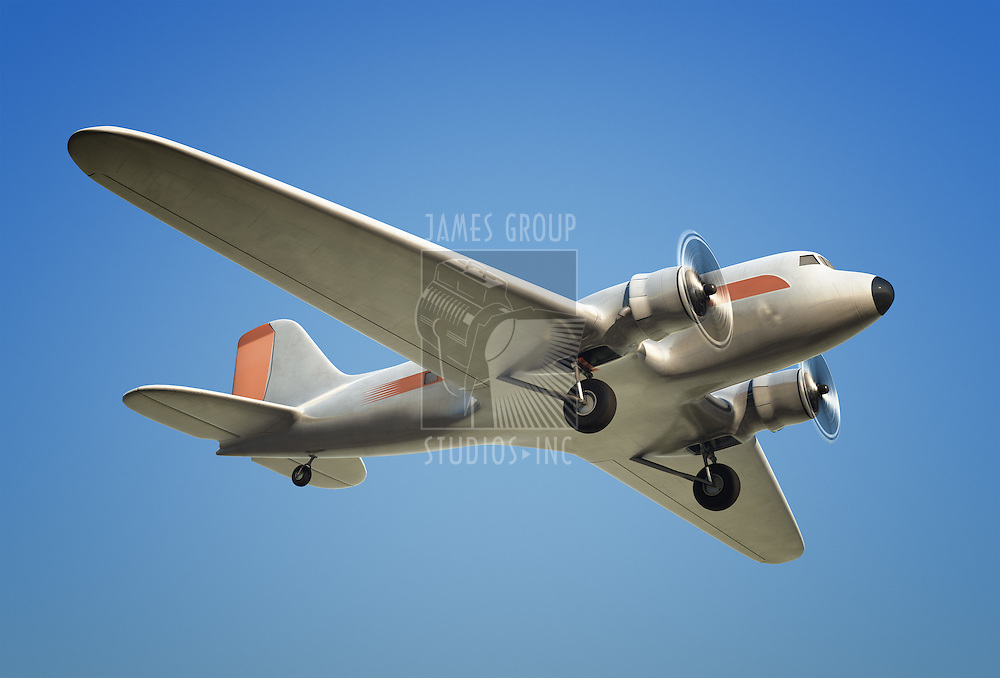 A Shot of a DC3 airplane in flight against a blue sky