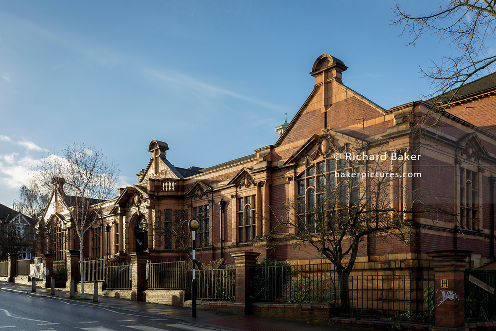 Exterior of the Carnegie Library on Herne Hill in south London which re-opens for the first time in almost 2 years, on 15th February 2018, in London, England. Closed by Lambeth council and occupied by protesters for 10 days in 2016, the library bequeathed by US philanthropist Andrew Carnegie has been locked ever since because, say Lambeth austerity cuts are necessary. A gym that locals say they don't want or need has been installed in the listed basement and actual library space a fraction as before and it's believed no qualified librarians will be present to administer it. Protesters also believe this community building will ultimately sold off by Lambeth council for luxury homes.