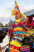 A traditional Cajun Mardi Gras costumed participant on horseback during the Courir de Mardi Gras chicken run on Fat Tuesday February 17, 2015 in Eunice, Louisiana. Cajun Mardi Gras involves costumed revelers competing to catch a live chicken as they move from house to house throughout the rural community.