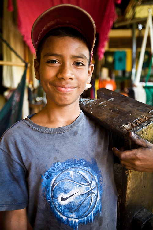 A shoe shine boy smiles in Masaya. Masaya is close to Granada in Nicaragua. Masaya is famous for its art markets where it sells crafts from the surrounding region. It is also a major regional transport hub.