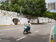 13 AUGUST 2016 - BANGKOK, THAILAND: The old Bangkok city wall is the boundary of the Pom Mahakan slum. Residents of the slum have been told they must leave the fort and that their community will be torn down. The community is known for fireworks, fighting cocks and bird cages. Mahakan Fort was built in 1783 during the reign of Siamese King Rama I. It was one of 14 fortresses designed to protect Bangkok from foreign invaders. Only of two are remaining, the others have been torn down. A community developed in the fort when people started building houses and moving into it during the reign of King Rama V (1868-1910). The land was expropriated by Bangkok city government in 1992, but the people living in the fort refused to move. In 2004 courts ruled against the residents and said the city could take the land. Eviction notices have been posted in the community but most residents have refused to move. Residents think Bangkok city officials will start evictions around August 15, but there has not been any official word from the city.   PHOTO BY JACK KURTZ