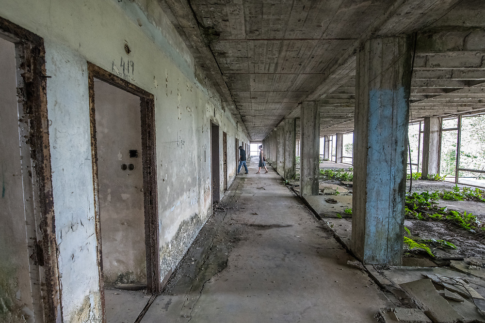 People explore the interior of the abandoned Ducor Hotel, once the most prominent hotels in Monrovia, Liberia