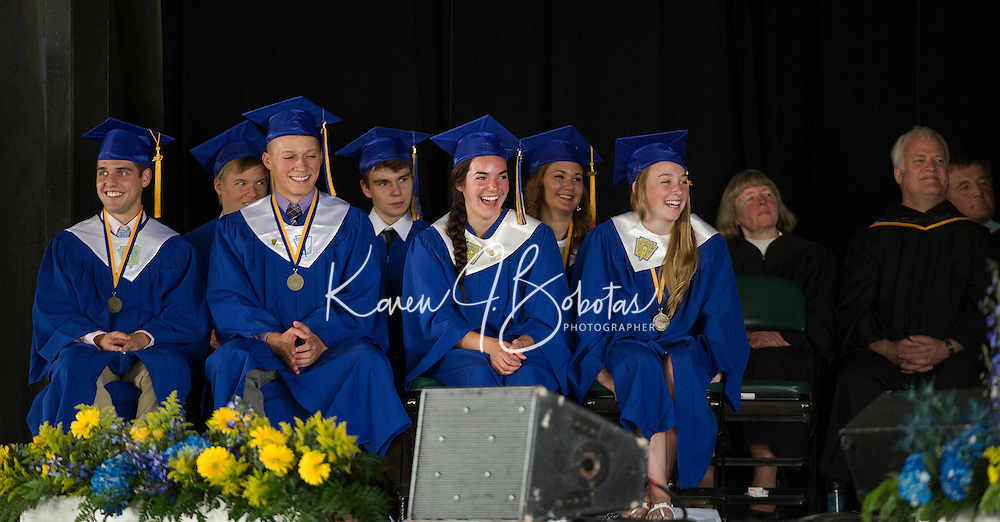 Class President Michael Czerwinski, Vice President Malcolm Benavides, Treasurer Ellouise McGonagle and Secretary Katherine Rice enjoy a laugh during Mr. Corey Nazer's Keynote Address at Gilford High School's graduation ceremony at Meadowbrook Pavilion Sunday morning.  (Karen Bobotas/for the Laconia Daily Sun)