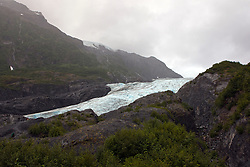 General view Exit Glacier with cloudy overcast sky, Kenai Fjords National Park, Alaska, United States of America