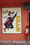 Super Chicken advertisement on a restaurant wall in Francisco Escarcega Campeche, Mexico. Yucatan, Mexico. (Supporting image from the project Hungry Planet: What the World Eats).