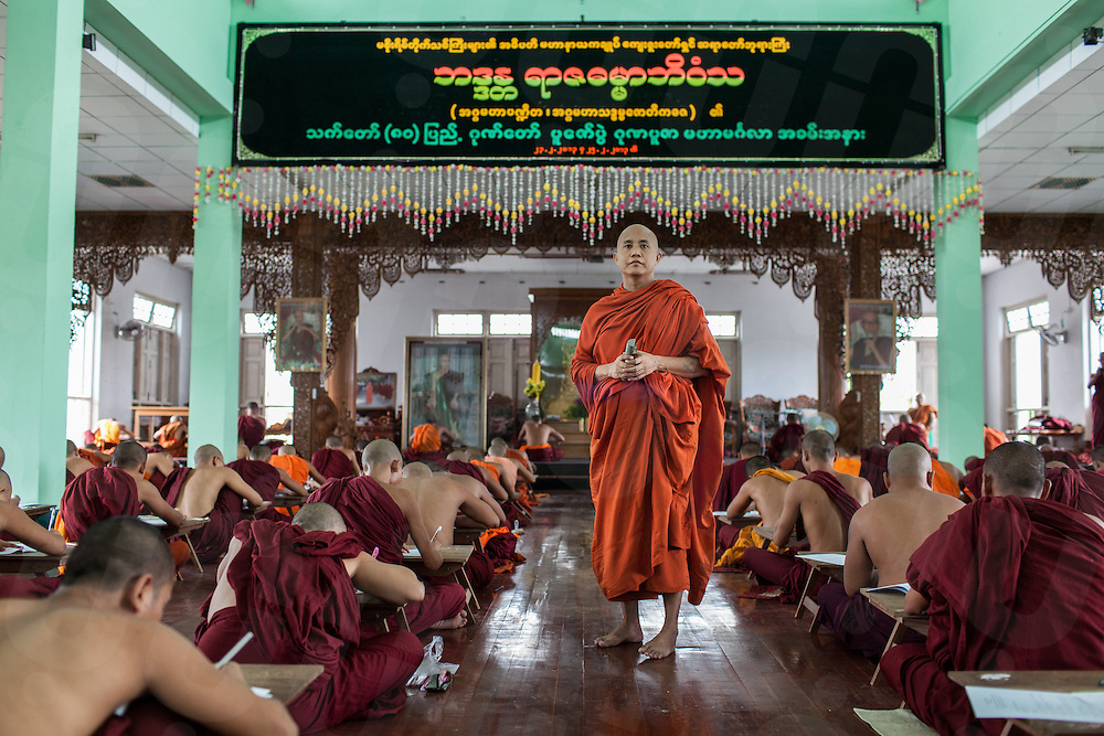 Monk Wirathu supervises an exam at Masoeyein Monastery in Mandalay. Since publicly promoting the 969 movement on social networks, Wirathu has been labeled as the Buddhist Bin Laden. 08 June 2013 © Nicolas Axelrod / Ruom