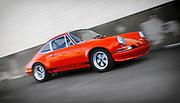 Image of Nick Psyllos driving his 1972 Tangerine Porsche 911 T/ST at Luftgekuhlt in San Pedro, California, America west coast